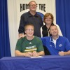 Josh Signing with Coach and Parents