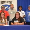 Kelsay with Family and Coaches