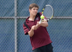 Radnor's Josh Taylor smacks a backhand return during his 6-0, 6-1 victory over Unionville s Zack Sokoloff at second singles that helped the Raiders claim a 3-2 victory in the District One Class AAA quarterfinal match Tuesday. (Tom Kelly IV)