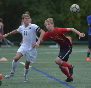 Radnor forward Ryan Peter, left, battles with Patrick Stroup of Penncrest Thursday. Peter scored twice in the first half of a 4-0 Radnor win. (Digital First Media/Pete Bannan)