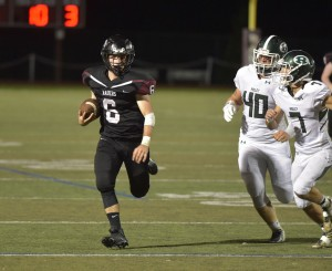 Pete Bannan — Digital First Media Radnor's Matt Cohen, left, did a lot of running past Ridley defenders Friday night, scoring five touchdowns in Radnor's 63-21 romp over Ridley