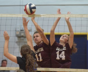 Radnor's Josie Darrach and Izzy Criscuolo, right, cover the net against Springfield's Kate Kubiak in game one of their Central League volleyball match at Springfield. (Pete Bannan/Digital First Media