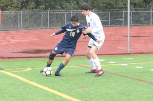 Spring-Ford's Sal Ibarra (12) possesses the ball while Radnor's Eliot Hayes moves in to defend during Saturday's game. (Thomas Nash - Digital First Media)