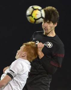 Radnor's Eliot Hayes, here winning a header over Henderson's Sam Martin in the second round of the District 1 Class 4A tournament, scored twice Tuesday to send the Raiders past Cumberland Valley, 3-2, in the opener of the PIAA tournament. (Pete Bannan/Digital First Media