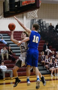 Garnet Valley's Ryan McCrossan, left, here driving against Springfield's Nick Fox in a December game, will have his hands full with Downingtown West's lanky front line in the District One Class AAAA opener Friday. (Times File)
