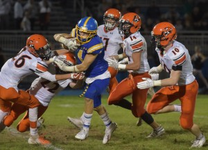 Springfield's Liam DiFonzo fights off a crowd of Marple Newtown tacklers during their game Friday night. (Pete Bannan/Digital First Media)