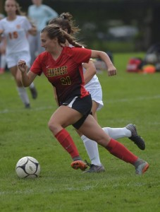Penncrest's Kenna Kaut dribbles the ball past Haverford's Alyssa Hayes in the second half of their Central League match Thursday. Kaut had the game's lone goal. (Pete Bannan/Digital First Media)