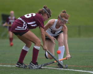 Radnor defender Olivia DeCain, right, battles Conestoga's Annie Hirshman for the ball in a game this season. DeCain anchored a defense that paced the Raiders to 14 straight wins. (Pete Bannan/Digital First Media