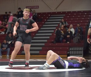 Garnet Valley's Coltin Deery, left, celebrates after pinning Upper Darby's Pat Kerwood in the heavyweight match Wednesday. Deery's win helped fuel a 55-15 win for the Jags. (Digital First MEdia/Pete Bannan