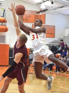 Penncrest's Malcolm Williams goes up for a shot over Conestoga's Brooks Rush during the Central League semifinal Saturday between the teams. (Pete Bannan/Digital First Media)