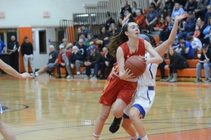 Erin Kelly, pictured in a Central League playoff game last season, has been an effective backcourt leader for the Fords